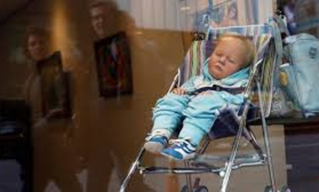 That's art?' Baby turns heads in Manhattan auction house window