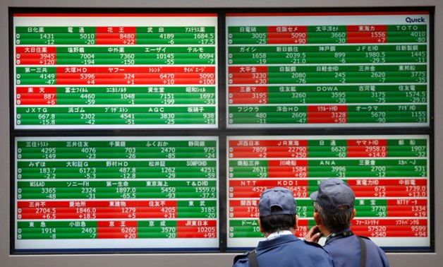 Asian shares steady as Fed looms, May's Brexit deal in chaos