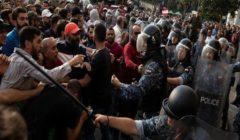 قوى الأمن اللبنانية تتدخل للسيطرة على اشتباكات بين محتجين ورافضين للاحتجاجات