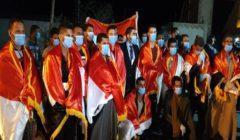 """صور - """"صقور مصر وكل الخيارات متاحة"""".. كواليس عودة العمال المصريين من ليبيا"""